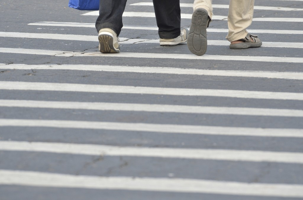 crossing the street safely at crosswalk